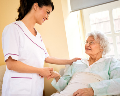 a caregiver taking care of a woman