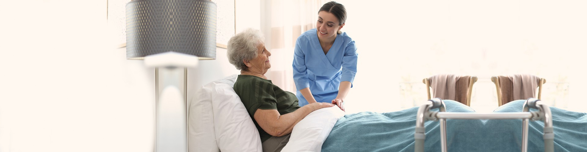 a caregiver attending to her patient
